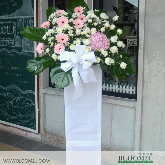 pink condolence stand